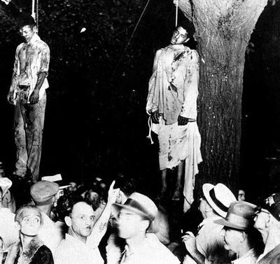 7 de abril de 1930,Thomas Shipp e Abram Smith, ambos de 19 anos, linchados e enforcados em Indiana
